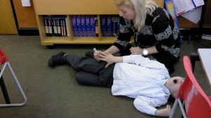 Simulation from Lazarus Training materials of epipen from schools first aid course